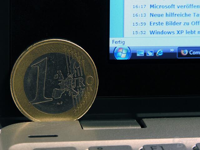 Start-Button und Ein-Euro-Stück im Vergleich