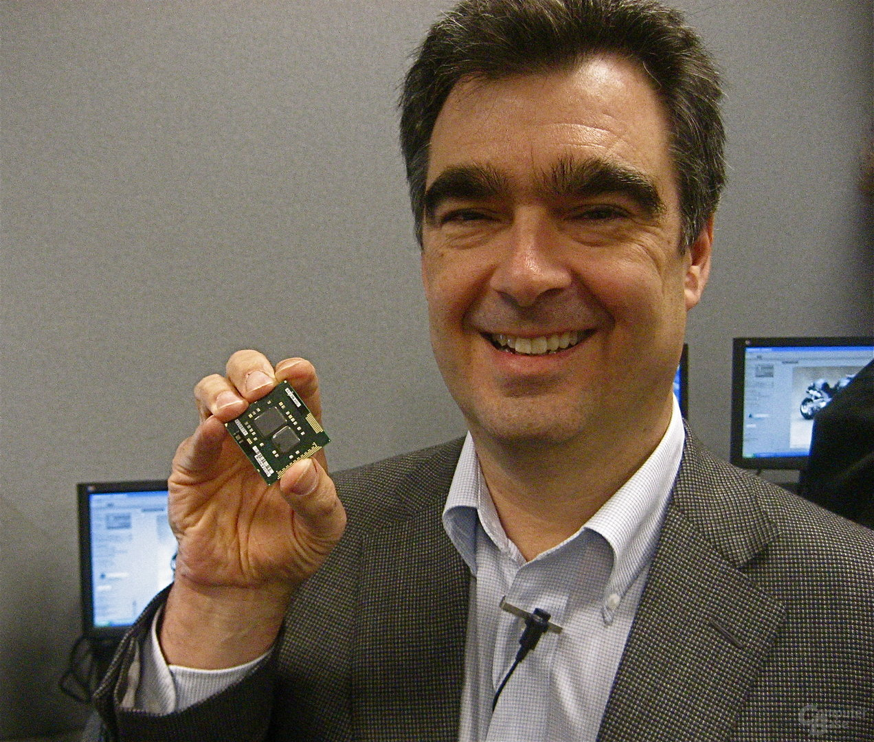 Intel Vice President Steve Smith shows 32nm Westmere microprocessor.