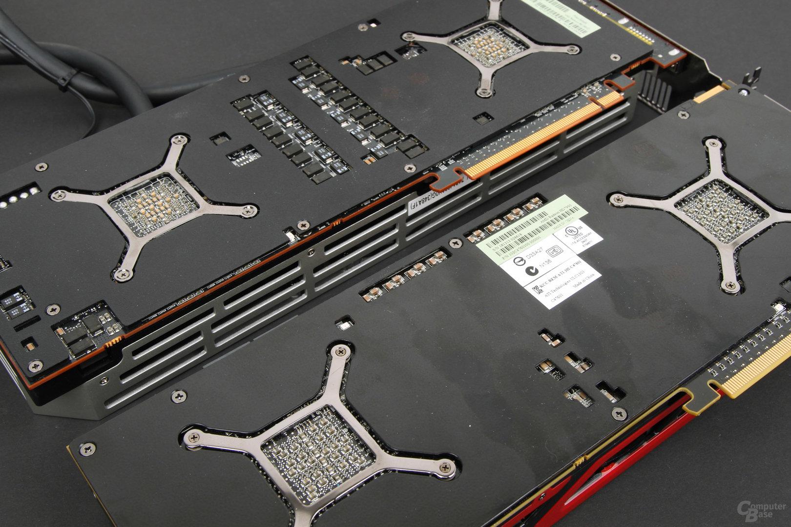 AMD Radeon R9 295X2 (oben) vs. Radeon HD 7990 - Rückseite