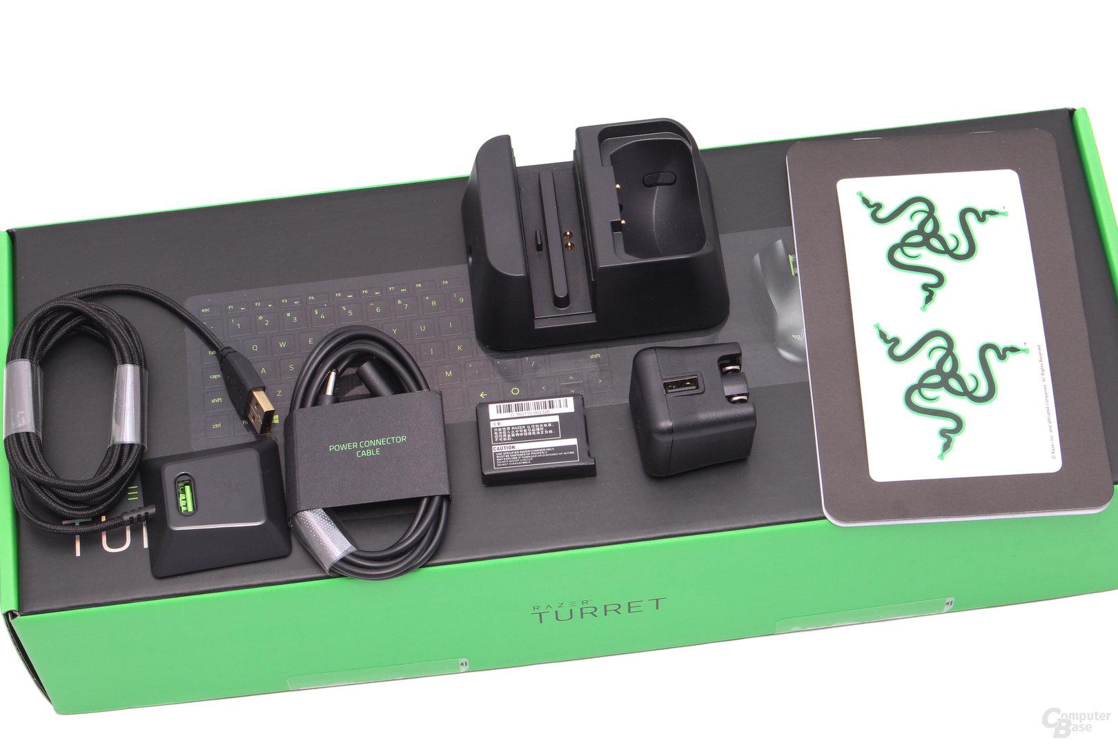 Kurzanleitung, Sticker, Ladestation und -stecker, USB-Verlängerung, Anschlusskabel