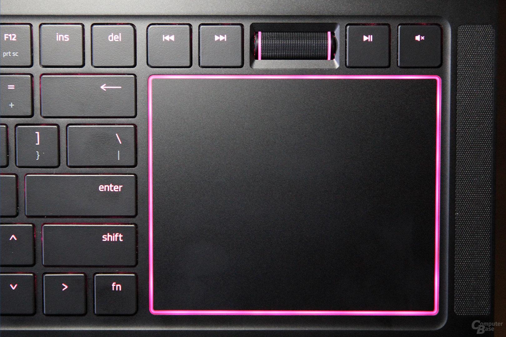 Das Touchpad neben der Tastatur mit Lautstärkerad