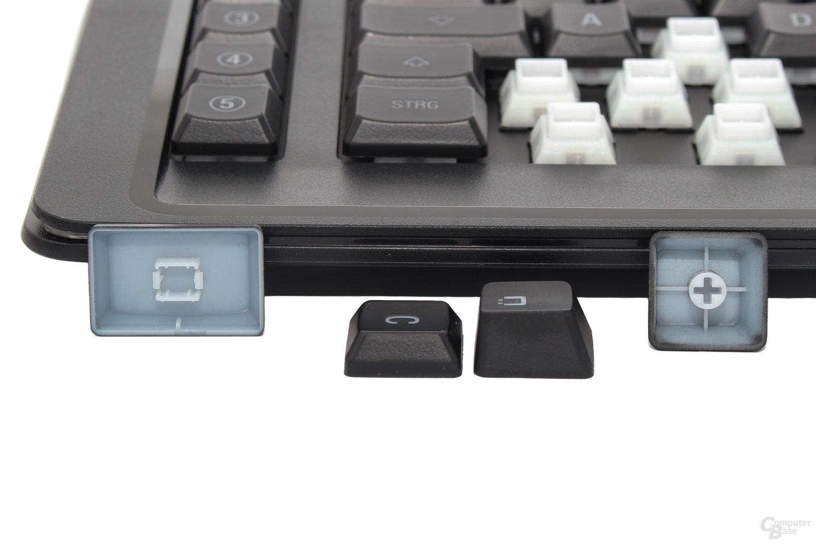 Dabei halbiert sich die Bauhöhe im Vergleich mit normalen Tastenkappen (rechts) etwa