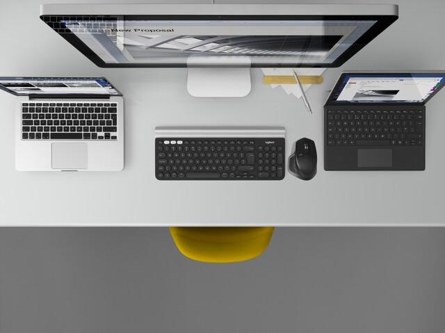 Mac und PC mit einer Maus im fließenden Übergang bedienen