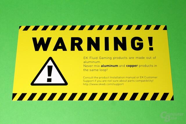 EK Fluid Gaming: Der Warnhinweis vor Kupfer kann nicht übersehen werden
