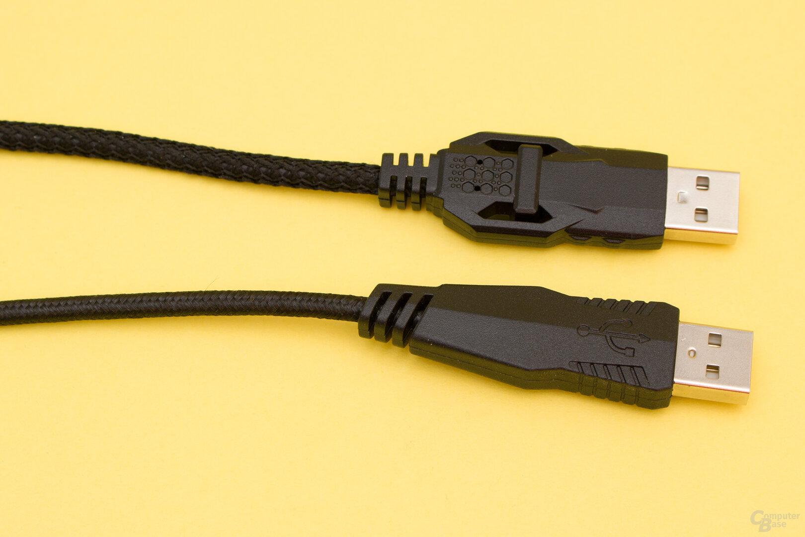 Der USB-Anschluss und das Kabel des günstigeren Quyre (oben) fallen robuster aus als die des teureren Orios (unten)